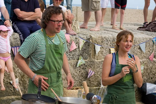 Celebrity chef Hugh Fearnley-Whittingstall getting out and about cooking for the public at a fish B-B-Q on Lyme Regis beach.