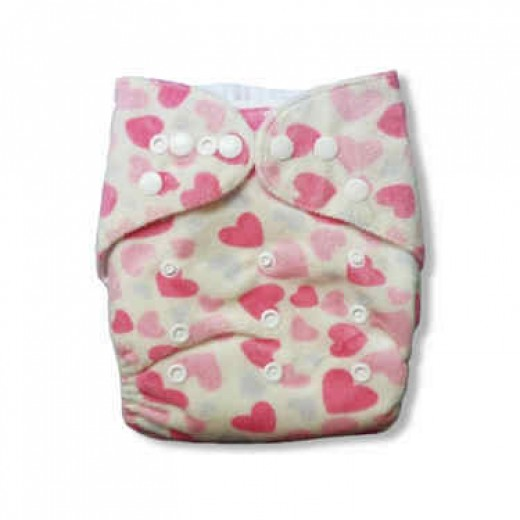 Alva cloth diaper, with heart print.