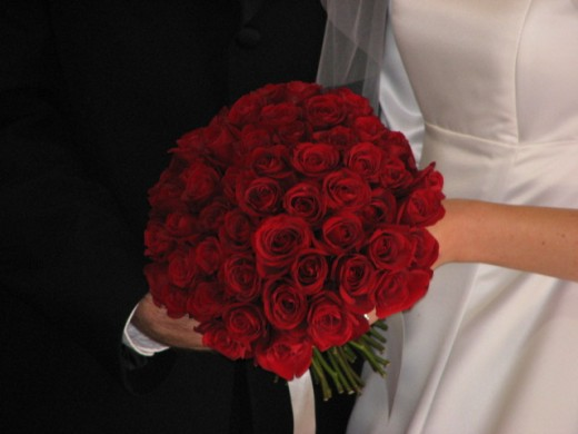 A round bouquet utilizing a single flower with no greenery.