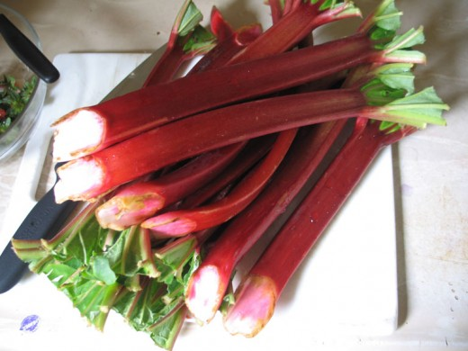 Rhubarb stalks.  Ruby colored, the fruit tastes wonderful when cooked with sugar.  Rhubarb is also delicious when paired with strawberries.