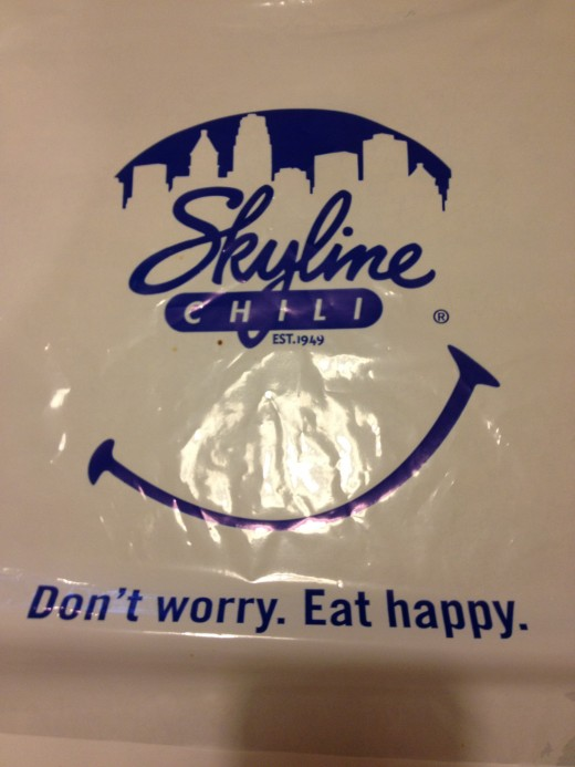 The bib is standard wear when you dine at Skyline Chili.  It keeps you happy!