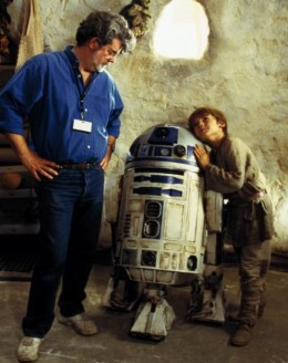 George Lucas with R2D2 and Jake Lloyd.