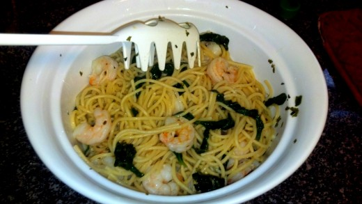 After draining the water, add the noodles to a serving dish and pour the shrimp mixture over the pasta.