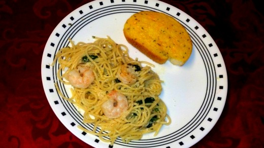 Our finished shrimp pasta with sauteed spinach served with cheese toast.