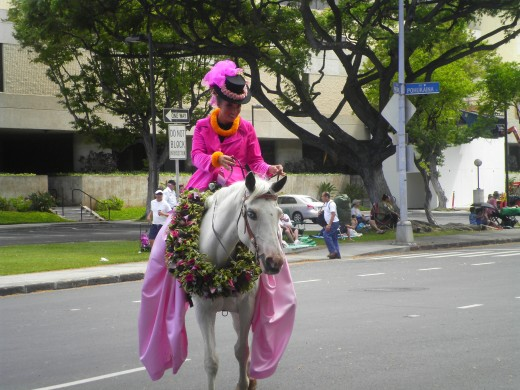 Pa'u riders are draped in long satin gowns, and the horses wear handmade flower lei