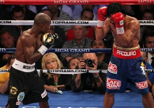 Lady Boxing Judge C.J Ross looks at Bradley