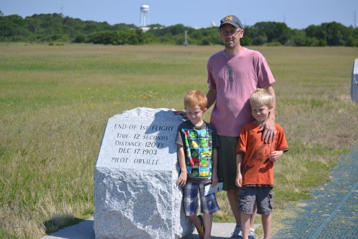 My children and husband by a flight line marker at the Wright Brothers National Memorial in North Carolina
