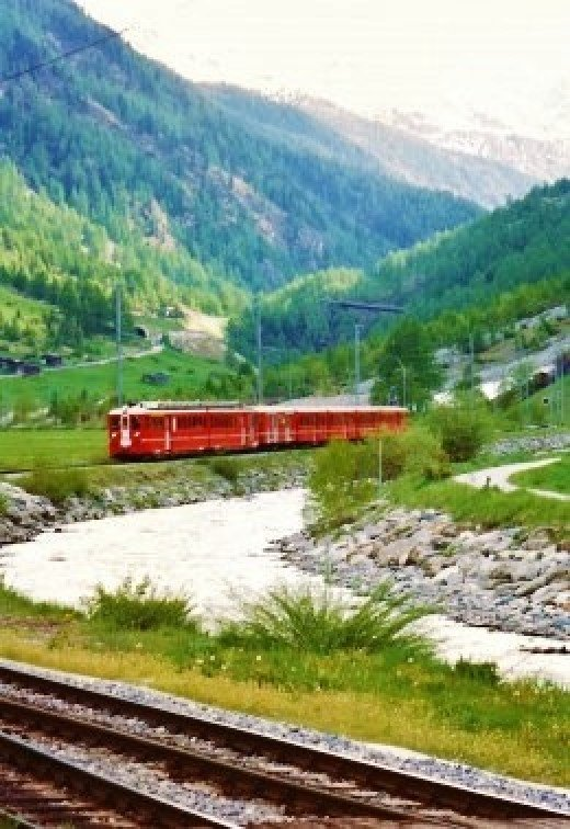 Glacier Express Train coming into Tasch, Switzerland
