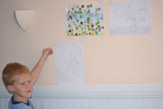 My son adding his art work to the gallery