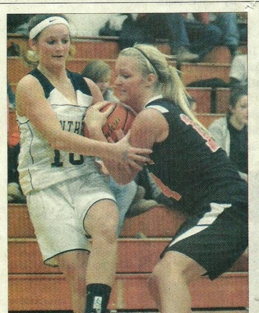 This picture was in the paper. I l gave the referee who didn't call a foul a copy the next game.