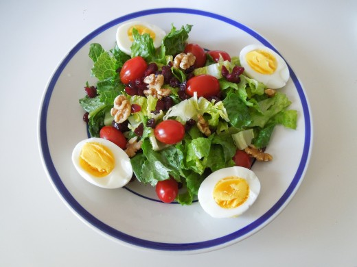 Boiled Egg Salad: Egg, Walnuts, Raisins, Lettuce, Grape tomato.