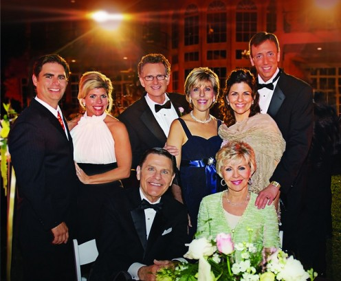 INNER-CORE OF KENNETH COPELAND MINISTRIES. KENNETH AND WIFE, GLORIA ARE KNEELING.