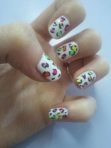 Create a twist in the leopard print by using multi colors - use different colors to make the dots and you will end up with cool funky leopard print nails