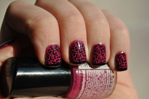 These leopard nails were created using only two colors and using a stamping tool . They are simple yet look great :)