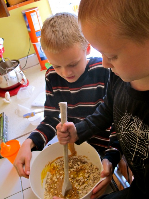 My oldest son (age 10) helps his youngest brother (age 5) make granola bars for snack.