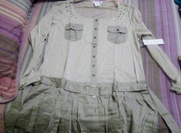 This is a shirt.  I know it looks like a dress but I think it would go good with some skinny jeans.