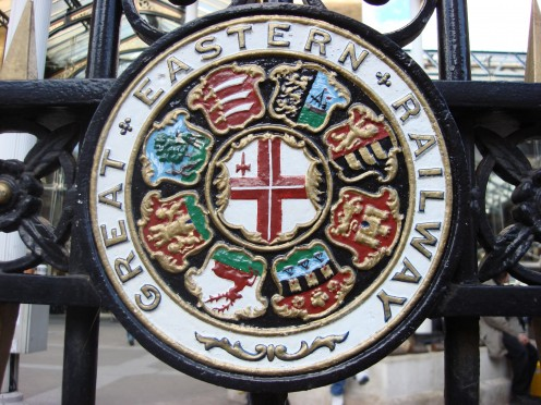 Great Eastern Railway heraldic device at Liverpool Street station, London. Comprised the shields of (clockwise from 1 o'clock): Maldon, Ipswich, Norwich, Cambridge, Hertford, Northampton, Huntingdon, and Middlesex; centre: City of London.
