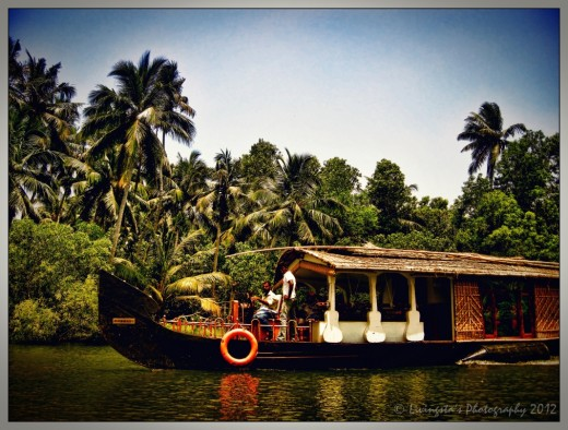 A boathouse cruising on the river