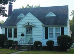 Symmetrical Cape Cod bungalow.