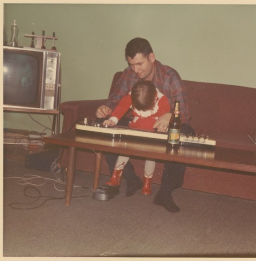 Dad letting me help him play his first steel guitar.