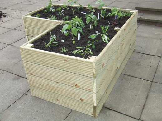 A small raised bed that will fit nicely into a corner of your yard.