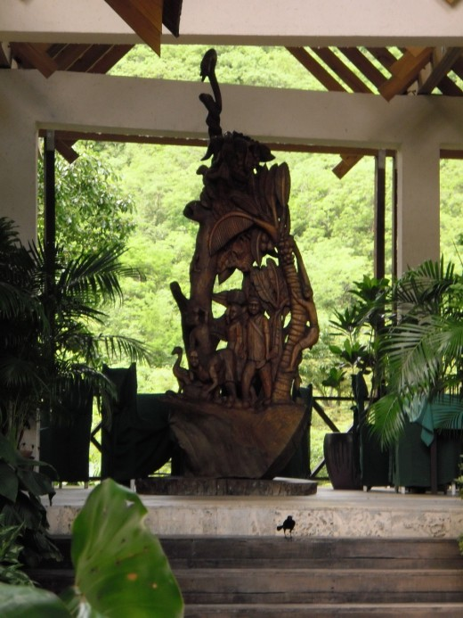 Sculpture by Choiseul artist Lawrence Deligny at the Port Cochere, l'Anse Chastanet, where the minibus leaves for Soufriere and  the Qualibou Drive-in Volcano tour.