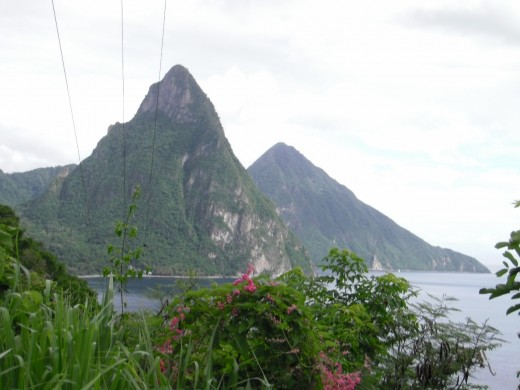 Gros Piton and Petit Piton are volcanic peaks that landmark the island.  Over the Choiseul Tuff behind them that forms part of the lip of the caldera is the crater of the still-active volcano.