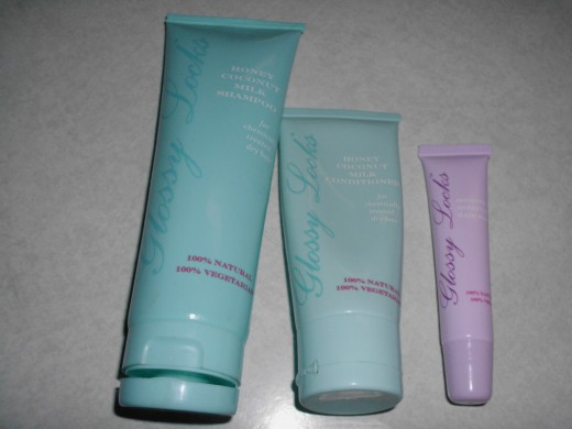 100 Percent Pure company shampoo, conditioner and pink one is moisture balm.