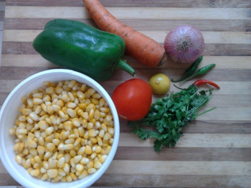 Boiled sweet corn, carrot, green bell pepper, lemon, onion, green chillies, some coriander leaves