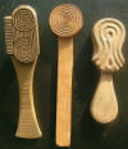 Wooden paddles used in marking pottery
