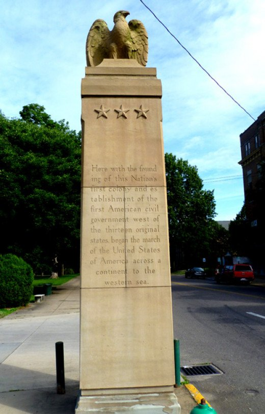 A monument to westward American expansion at the foot of Putnam Bridge