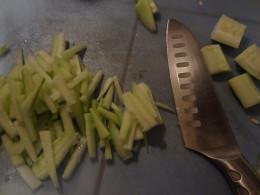 Chop cucumber into matchsticks