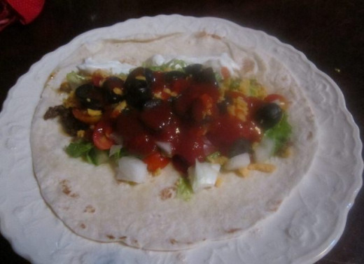 Load tortilla with fillings.