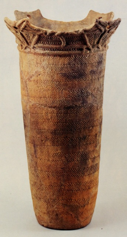 A middle Jomon-period jar. Note the rope imprints and elaborate flame-shaped rim.