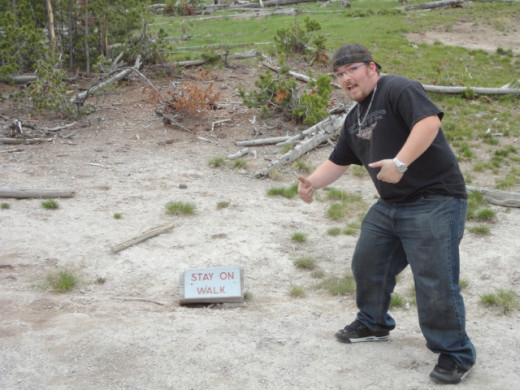 Our friend Corey visiting from Utah demonstrating what not to do in Yellowstone.