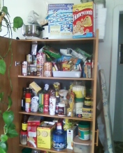 A little cluttered, but it serves its purpose. Note there is one more shelf below as well.