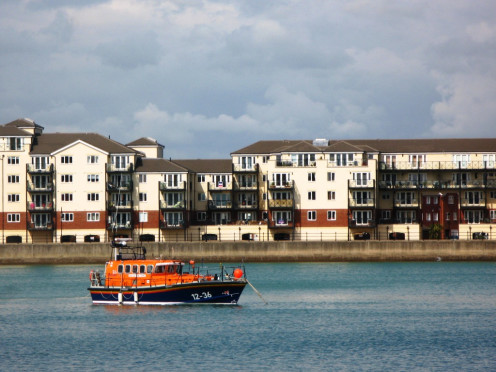 Mersey Class lifeboat 12-36 Royal Thames at its moorings in Soverign Harbour, Eastbourne, Sussex.