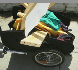 """Great stuff gathered on a ride around town.   - Stack of clothes from a garage sale.   - Stack of books from the sidewalk. - Ikea twin bedframe labeled """"Free to a Good Home""""  \(^_^)/"""