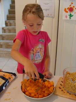 Grace smashes the vegetables next.