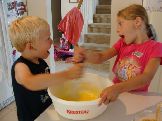 Together the kids get silly while mixing the eggs!