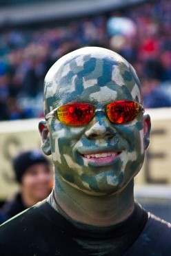 True sports fanastics paint their faces before attending a sporting event.