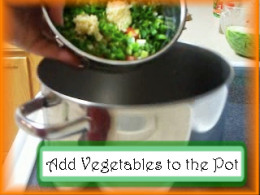 Adding Albondigas Vegetables to the Pot: Put tomatoes, onions and garlic into a soup pot.