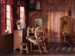 SPINNING WHEELS were used to spin thread to sew the clothing of early American pioneers.