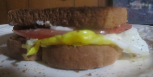 A lovely fried egg sandwich with a piece of cold cuts added