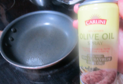 Spray with non-stick cooking spray. Here I use olive oil spray. You could also use butter.