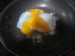 Bust and spread out the egg yolk.