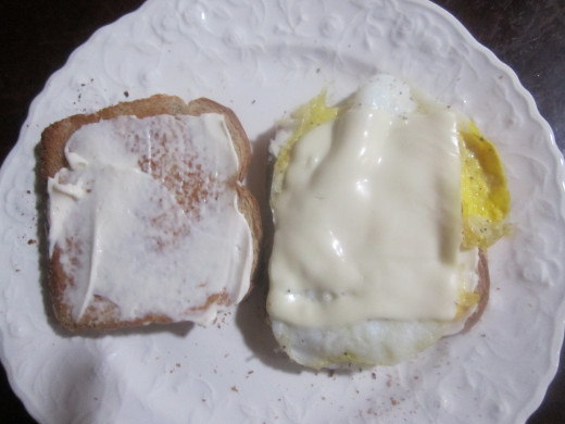 After mayo, put the egg and cheese (I used processed Swiss!) on the bread.