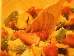 Be sure that all your fruit, couscous, and mint leaves get well coated with the liquids for the best flavor.