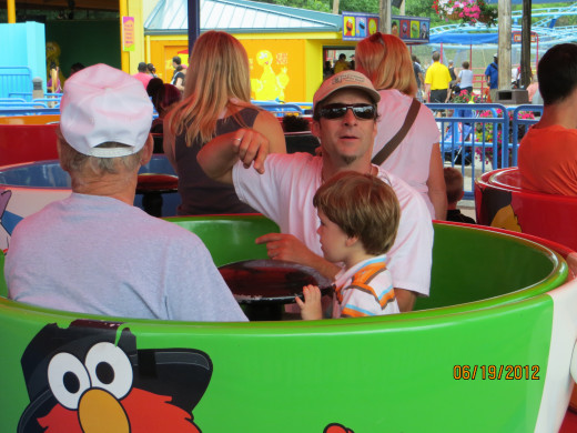 On the teacups with Dad and Grandpa