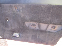 What the door panel looks like without door handle back plate and armrest.